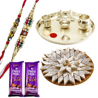 Popular Arrangement of Silver Plated Thali with Ganesh Lakshmi, Sweet Kaju Katli and Raymonds Gift Voucher along with 2 free Rakhi, Roli Tilak and Chawal for Rakhi Celebration