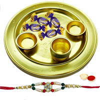Ecstatic Arrangement of Four Eclairs Chocolates and Golden Plated Lota Puja Thali with Free Rakhi, Roli Tilak and Chawal for Rakhi Celebration
