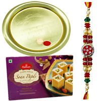 Beautifying Gift of Gold Plated Thali and Sweet <font color=#FF0000>Haldiram</font> Soan Papri with Free Rakhi, Roli Tilak and Chawal