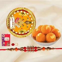 Ecstatic Arrangement of Laddoo from Haldiram and Pious Rakhi Thali along with Rakhi, Roli Tilak and Chawal for Rakhi Celebration