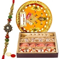 Delicious Assortments of Sweets from <font color=#FF0000>Haldiram</font> and Rakhi Thali with Free Rakhi, Roli Tilak and Chawal for your Caring Brother