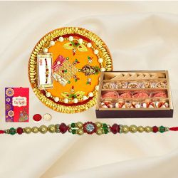 Assorted Sweets and Designer Pooja Thali along Rakhi, Roli, Tilak and Chawal