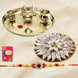 Delicious Kaju Katli and Stylish and Trendy looking Silver Plated Paan Shaped Puja Aarti Thali along Rakhi, Roli, Tilak and Chawal