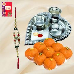 Yummy Arrangement of Laddoo from Haldiram and Silver Plated Paan Shaped Puja Thali along with Rakhi, Roli Tilak and Chawal for this Grand Raksha Bandhan