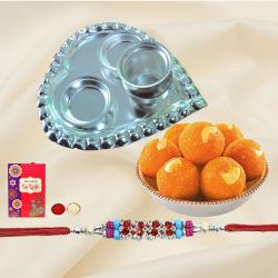 Yummy Arrangement of Laddoo from <font color=#FF0000>Haldiram</font> and Silver Plated Paan Shaped Puja Thali along with Rakhi, Roli Tilak and Chawal for this Grand Raksha Bandhan