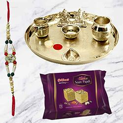 Soan Papri and Stylish and Trendy looking Silver Plated Paan Shaped Puja Aarti Thali along Rakhi, Roli, Tilak and Chawal
