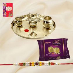 Flattering Arrangement of <font color=#FF0000>Haldiram</font> Soan Papri with Stylish Silver Plated Paan Shaped Puja Aarti Thali and Rakhi with Roli Tilak N Chawal