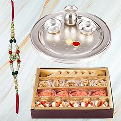 Charismatic Assortment of Sweets in a Pack and Pious Silver Plated Paan Shaped Puja Aarti Thali along with Rakhi, Roli Tilak and Chawal for your Dear Brother