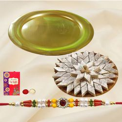 Delightful Gift Set of <font color=#FF0000>Haldiram</font> Kaju Katli and Gold Plated Puja Thali with Rakhi, Roli Tilak and Chawal for this Raksha Bandhan<br>