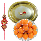 Laddoo and Silver Plated Puja Thali along Rakhi, Roli, Tilak and Chawal