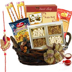 Stunning Collection of Rakhi Tidbits in a Hamper with Free Rakhi, Roli Tilak and Chawal for the Occasion of Raksha Bandhan