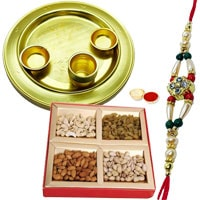 Delectable Assorted Dry Fruits and Decorative Gold Plated Thali Gift Set with Free Rakhi Roli Tilak and Chawal for your Dear Ones on Raksha Bandhan