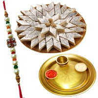 Spectacular Rakhi Special Gift of Gold Plated Pooja Thali and Delicious Kaju Katli from Haldiram with Free Rakhi, Roli Tilak and Chawal