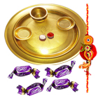 Enticing Display of Gold Plated Thali with Eclairs Chocolates and 1 Free Rakhi Roli Tilak and Chawal on this Raksha Bandhan