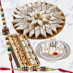 Breathtaking Arrangement of Gold Plated Thali with 2 Free Rakhi, Haldiram Kaju Katli N Dry Fruits along with Roli Tilak and Chawal
