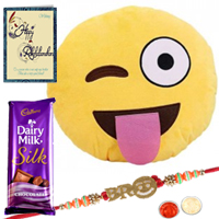 Smiley Cushion with Smiley Bro Rakhi and Cadbury Dairy Milk Silk Bar & a Rakhi Card with Roli Tilak and Chawal