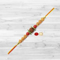 Marvelous Rudraksha Rakhi with Free Roli Tika and Chawal for your Loving Brother
