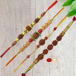 Remarkable Gift Set of Four Rudraksha Rakhi with Free Roli Tika and Chawal for your Loving Brothers