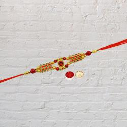 Exotic Selection of an Elegant Rakhi with Roli Tilak and Chawal for the celebration of Raksha Bandhan