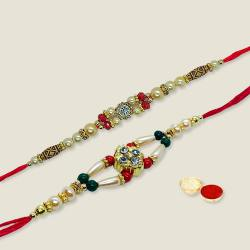Pious Arrangement of a Pair of Rakhi Set with free Roli Tilak and Chawal for Rakhi Celebration