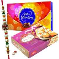 Irresistible Gift Pack of Soan Papri from <font color=#FF0000>Haldiram</font> and Cadbury Celebration Chocolate with Free Rakhi, Roli Tilak and Chawal for Sweet Rakhi Celebration