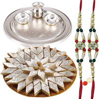 Fashionable Arrangement of <font color=#FF0000>Haldiram</font>s Badam Katli and Silver Plated Thali with Two Free Rakhi, Roli Tilak and Chawal for Rakhi Celebration