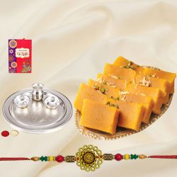 Tasty Collection of Soan Papdi N Silver Plated Thali with 1 Rakhi on Raksha Bandhan
