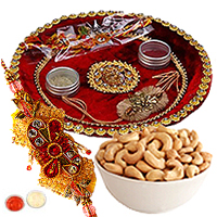 Exquisite Combo Gift of Rakhi with a Decorative Rakhi Thali and Spicy Cashew Nuts