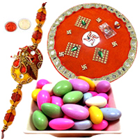 Spectacular Collection of Sugar Coated Almonds with Golden Rakhi Tray and One Pious Rakhi