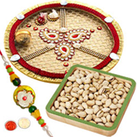 Exquisite Arrangement of One Trendy Rakhi with One Traditional Golden Thali and Roasted Pistachio Nuts