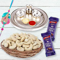 Impressionable Sisterly Love Gift of One Designer Rakhi with One Traditional Silver Rakhi Thali and Spicy Cashew Nuts