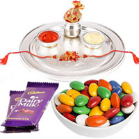 Beautiful Fusion Gift of an Attractive Silver Thali with a Designer Rakhi and Sugar Coated Almonds