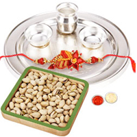Magnificent Raksha Bandhan Gift of Roasted Pistachio Nuts with One Trendy Rakhi and Silver Thali