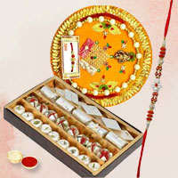 Remarkable Gift of Rakhi Thali N Pack of Assorted Sweets with One Adult Rakhi