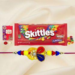 Classy Rakhi with Skittles Pack, Roli, Chawal N Card