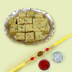 Exquisite Combo Gift of OM Rakhi N Soan Papdi