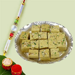 Beautiful White Bead Rakhi with Yummy Soan Papdi