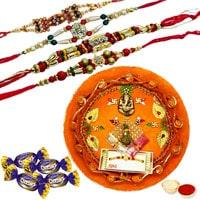 Appealing Combo Gift Pack of Yummy Chocolates and Rakhi Thali along with Rakhi, Roli and Tikka for Rakhi Celebration<br><br>