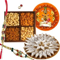 Appealing Gift Set of Yummy Kaju Katli and Dry Fruits and Decorative Rakhi Thali with 2 Rakhi, Roli and Tikka for your Loving Brother<br>
