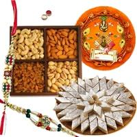 Appealing Gift Set of Yummy Kaju Katli and Dry Fruits and Decorative Rakhi Thali with 2 Rakhi, Roli and Tikka for your Loving Brother<br>