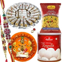 Fantastic Composition of Rakhi Delicacies in a Hamper along with Rakhi Thali, 2 Rakhi, Roli and Tikka<br>