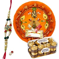 Enticing Gift Set of Rakhi Thali and 12 Pcs. Ferrero Rocher Box along with 1 Rakhi, Roli and Tikka on Raksha Bandhan<br><br>
