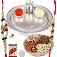 Charismatic Rakhi Celebration Gift Set of Designer Silver Plated Rakhi Thali and Dry Fruits Platter along with 2 Rakhi, Roli and Tikka