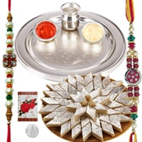 Sizzling Rakhi Wishes Gift of Delectable Kaju Katli and Rakhi Thali Set with 2 Rakhi, Roli and Tikka for your Loving Brother<br><br>