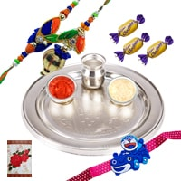Designer Silver Plated Rakhi Thali with One Pair of Rakhi Set for Bhaiya Bhabhi, One Cute Kids Rakhi and Three Chocolates along with Roli N Tilak for your Loving Brother on Rakhi Special