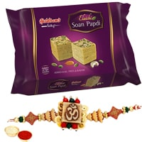 Outstanding Selection of 250 gr. Haldiram/Reputed Brand Soan Papri and One Designer Ethnic Rakhi with Roli N Tilak on the Occasion of Raksha Bandhan