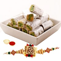 Auspicious Gift of One Ethnic Rakhi and Delicious Kaju Pista Roll with Roli N Tilak for your Dear Brother