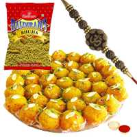 Scintillating Present of Fancy Rakhi with Boondi Ladoo n Haldirams Bhujia along with Roli Tikka for Your Cousins