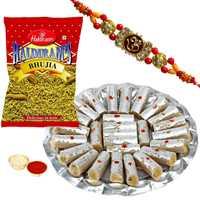 Classy Gift of Ethnic Rakhi with Delicious Kaju Pista Roll n Haldirams Bhujia along with Free Roli Tikka