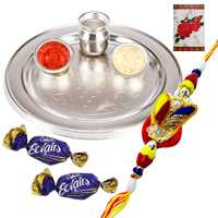 Outstanding Display of Silver Plated Rakhi Thali with Zardosi Rakhi and Chocolates along with Free Roli Tikka for the Occasion of Raksha Bandhan<br> <br>